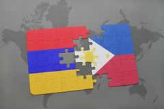 Puzzle with the national flag of armenia and philippines on a world map Royalty Free Stock Photos