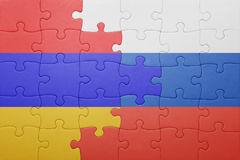 Puzzle with the national flag of armenia and russia Stock Photos