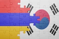 Puzzle with the national flag of armenia and south korea. Concept stock photography