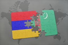 Puzzle with the national flag of armenia and turkmenistan on a world map Stock Photography