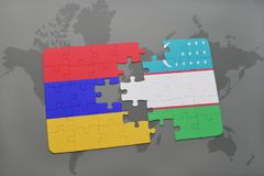 Puzzle with the national flag of armenia and uzbekistan on a world map Stock Photography