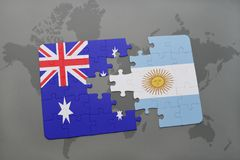 Puzzle with the national flag of australia and argentina on a world map background. Royalty Free Stock Photos