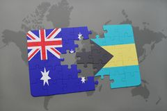 Puzzle with the national flag of australia and bahamas on a world map background. Royalty Free Stock Images
