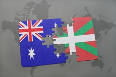 Puzzle with the national flag of australia and basque country on a world map background. Concept Stock Photo