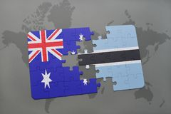 Puzzle with the national flag of australia and botswana on a world map background. Royalty Free Stock Images