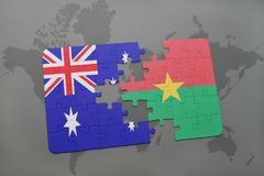 Puzzle with the national flag of australia and burkina faso on a world map background. Stock Photos