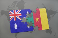 Puzzle with the national flag of australia and cameroon on a world map background. Royalty Free Stock Photo