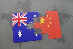 Puzzle with the national flag of australia and china on a world map background. 3D illustration Stock Photography