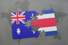 Puzzle with the national flag of australia and costa rica on a world map background. Royalty Free Stock Photos