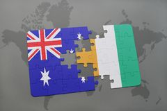Puzzle with the national flag of australia and cote divoire on a world map background. Royalty Free Stock Image