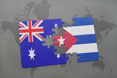 Puzzle with the national flag of australia and cuba on a world map background. Royalty Free Stock Image
