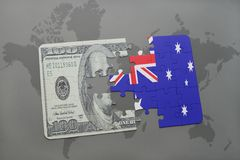 Puzzle with the national flag of australia and dollar banknote on a world map background. Royalty Free Stock Image