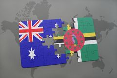 Puzzle with the national flag of australia and dominica on a world map background. Stock Image