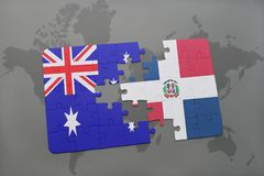 Puzzle with the national flag of australia and dominican republic on a world map background. Royalty Free Stock Images