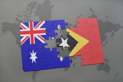 Puzzle with the national flag of australia and east timor on a world map background. Stock Images