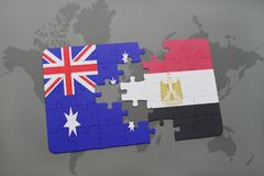 Puzzle with the national flag of australia and egypt on a world map background. Stock Image