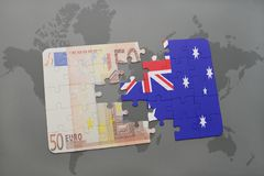 Puzzle with the national flag of australia and euro banknote on a world map background. Stock Photo