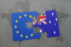 Puzzle with the national flag of australia and european union on a world map Stock Image