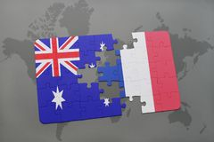 Puzzle with the national flag of australia and france on a world map background. Concept Royalty Free Stock Image