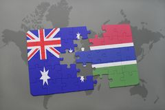 Puzzle with the national flag of australia and gambia on a world map background. Royalty Free Stock Photography