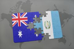 Puzzle with the national flag of australia and guatemala on a world map background. Royalty Free Stock Photo