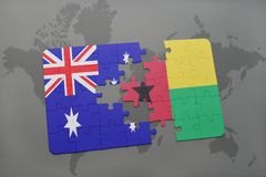 Puzzle with the national flag of australia and guinea bissau on a world map background. Stock Photography