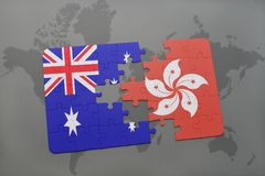 Puzzle with the national flag of australia and hong kong on a world map background. Stock Image