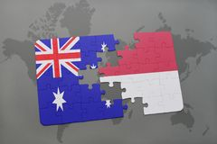 Puzzle with the national flag of australia and indonesia on a world map background. 3D illustration stock images