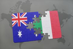 Puzzle with the national flag of australia and italy on a world map background. Concept Stock Photography