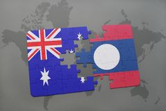 Puzzle with the national flag of australia and laos on a world map background. Royalty Free Stock Images