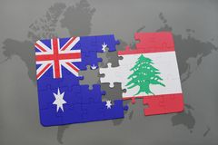 Puzzle with the national flag of australia and lebanon on a world map background. Stock Image