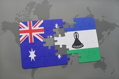 Puzzle with the national flag of australia and lesotho on a world map background. Stock Image