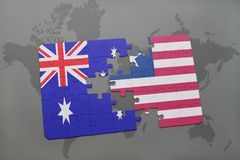 Puzzle with the national flag of australia and liberia on a world map background. Royalty Free Stock Photography
