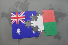 Puzzle with the national flag of australia and madagascar on a world map background. Stock Photography