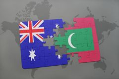 Puzzle with the national flag of australia and maldives on a world map background. Stock Photography
