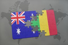Puzzle with the national flag of australia and mali on a world map background. Royalty Free Stock Photo