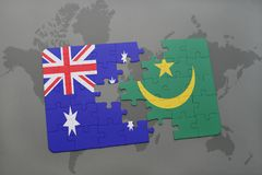 Puzzle with the national flag of australia and mauritania on a world map background. Stock Images