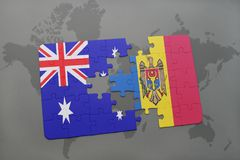 Puzzle with the national flag of australia and moldova on a world map background. Concept Royalty Free Stock Photography