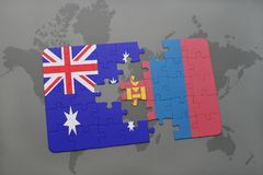 Puzzle with the national flag of australia and mongolia on a world map background. Royalty Free Stock Images