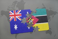 Puzzle with the national flag of australia and mozambique on a world map background. Royalty Free Stock Photography
