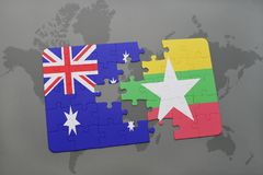 Puzzle with the national flag of australia and myanmar on a world map background. 3D illustration Royalty Free Stock Images