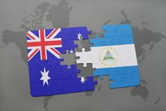 Puzzle with the national flag of australia and nicaragua on a world map background. 3D illustration Royalty Free Stock Images