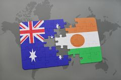Puzzle with the national flag of australia and niger on a world map background. Stock Photography