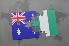 Puzzle with the national flag of australia and nigeria on a world map background. Stock Photo