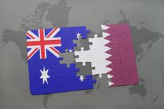 Puzzle with the national flag of australia and qatar on a world map background. Stock Photo