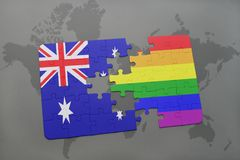 Puzzle with the national flag of australia and rainbow gay flag on a world map background. Concept Stock Image