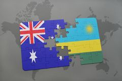 Puzzle with the national flag of australia and rwanda on a world map background. Stock Images