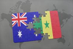 Puzzle with the national flag of australia and senegal on a world map background. Royalty Free Stock Images