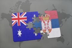 Puzzle with the national flag of australia and serbia on a world map background. Concept Royalty Free Stock Photography