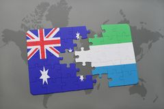 Puzzle with the national flag of australia and sierra leone on a world map background. Stock Photography
